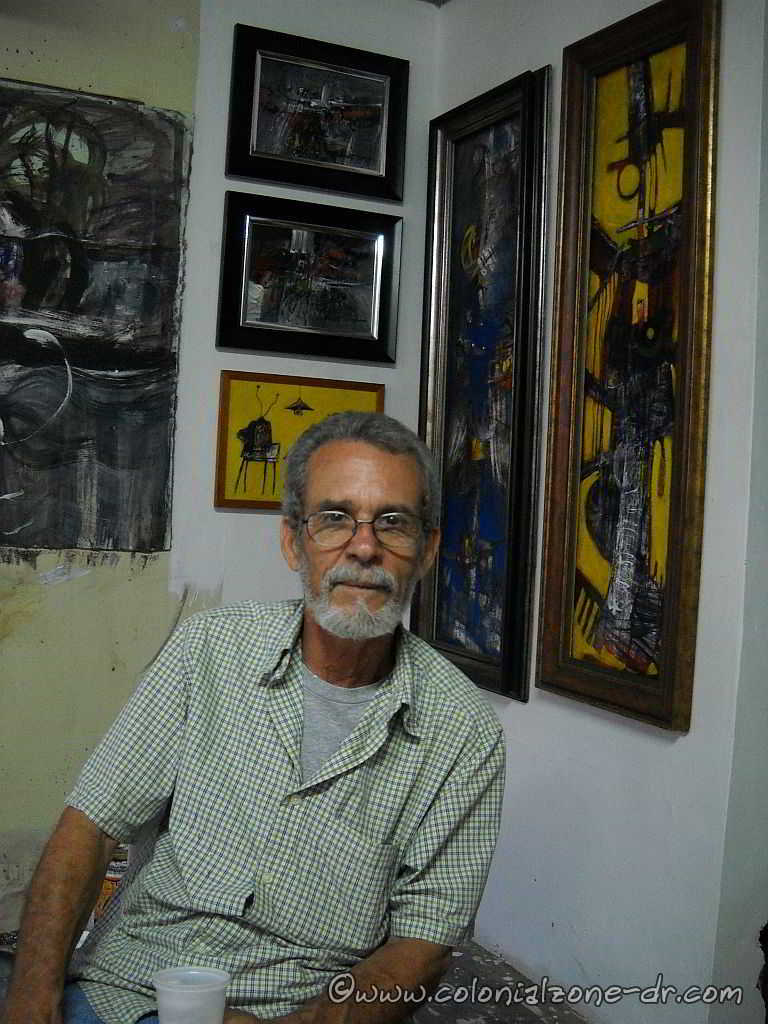 Dominican Artist Luis Oviedo W. with some of his unique paintings.
