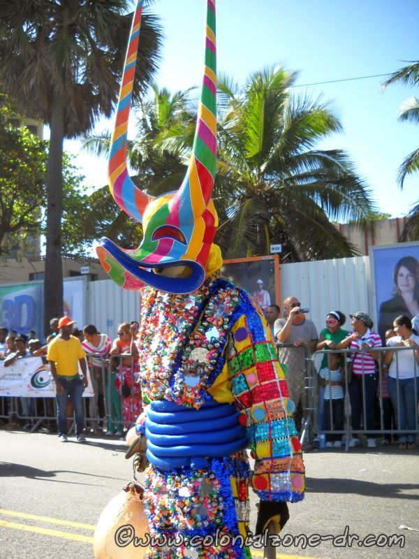the colorful mirrored lechones at carnaval dominicano
