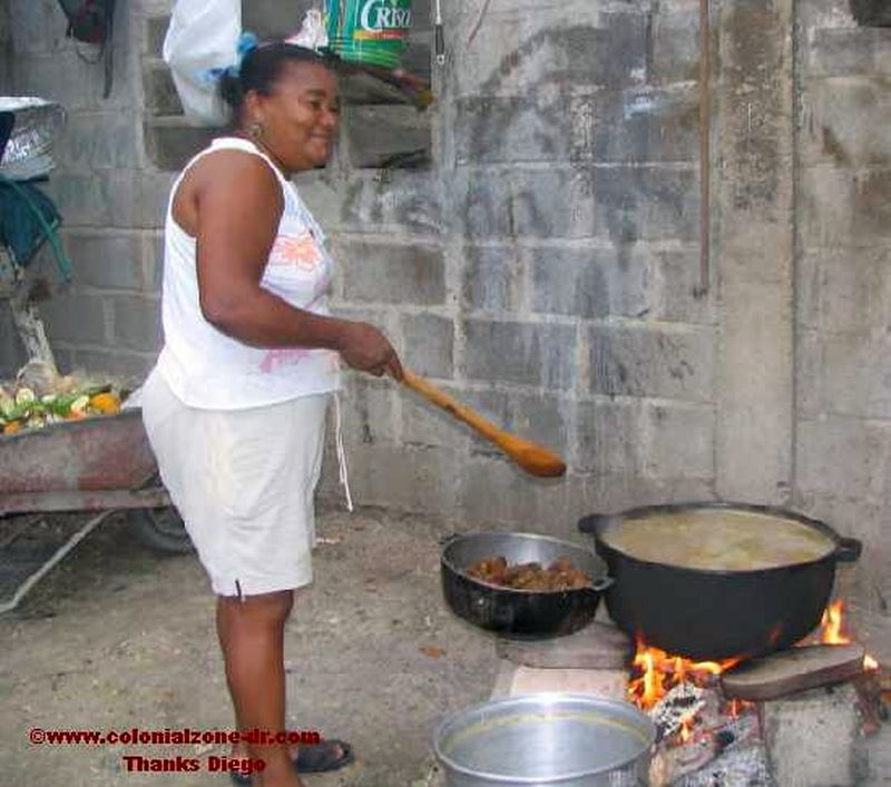 Pictures of the people of dominican republic pictureimage cooking sancocho on a fire forumfinder Choice Image