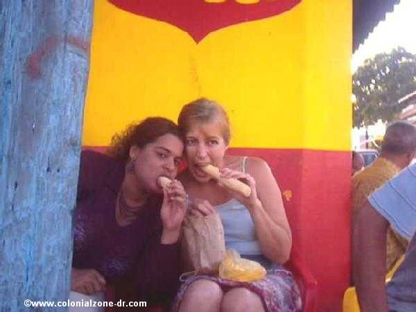 picture/image eating some ca�a/sugar cane while relaxing at the Colmado on a Sunday afternoon