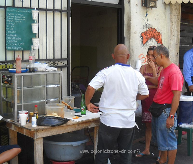 Cooking empinadas on the street in ciudad colonial santo domingo