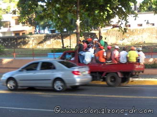 Pick-up truck taking people to work in the morning - another form of transportation in DR.