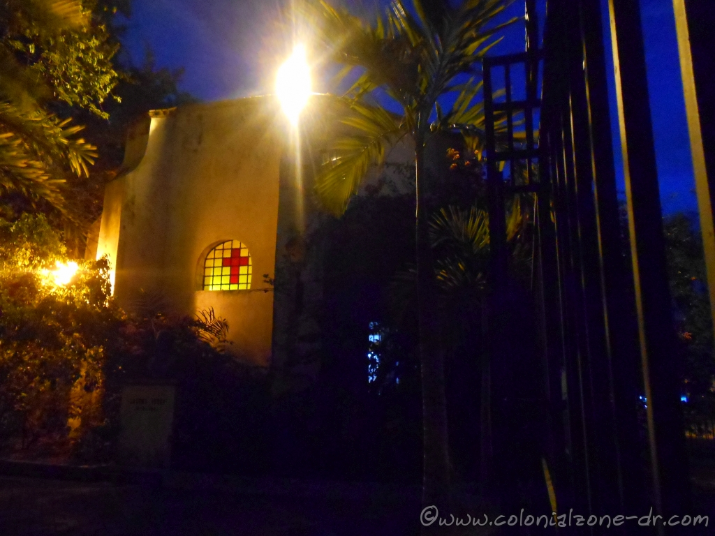 The back of the Capilla de la Tercera Orden Dominica at a small plaza at night