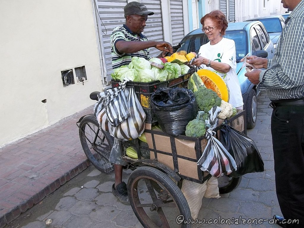 The street vendor vegetable man bringing his wares directly to the home