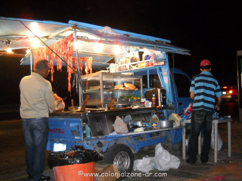 A street vendor truck selling pork sandwiches