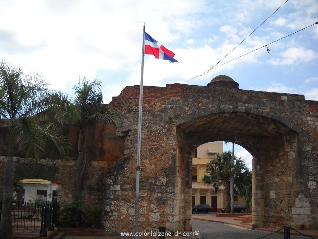Puerta de la Misericordia panoramic with the flag of Dominican Republic flying proudly above.