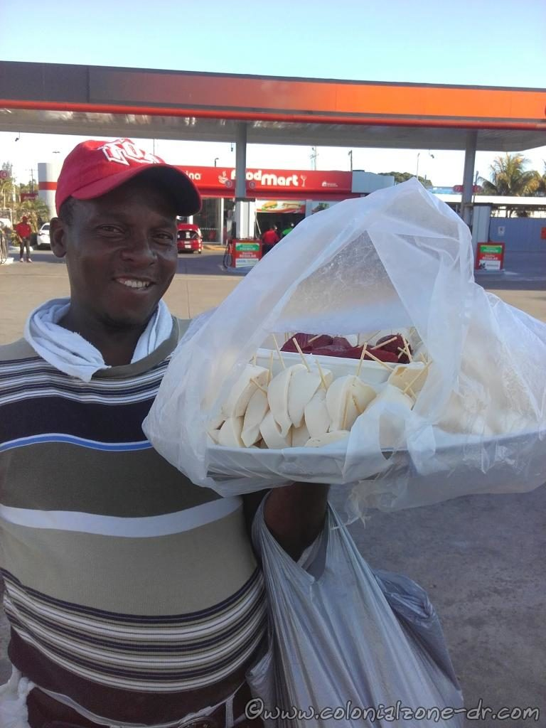 Quesero selling his cheese and he even has some salami on his tray.