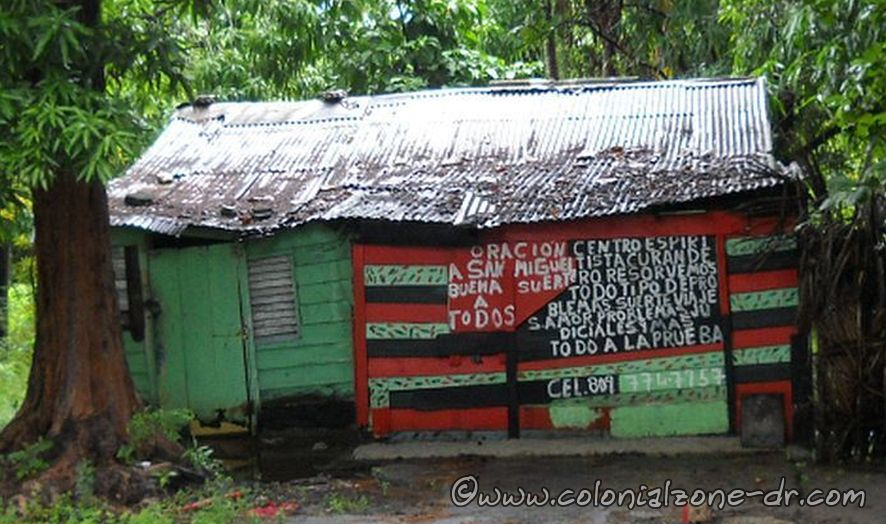"""Sign on the house reads in part translated """"San Miguel grants good luck to all"""""""