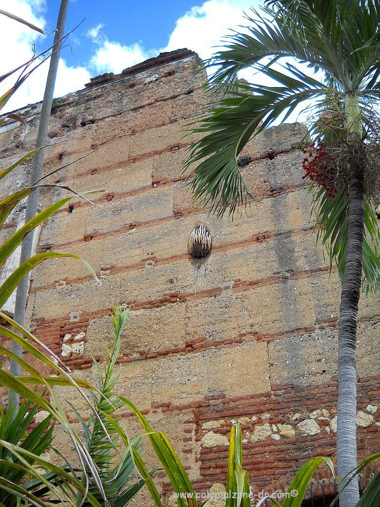 The beehive on the exterior wall of the Ruins of San Nicolas De Bari