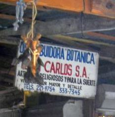 """Sign on a Brujaria """"Artículos religiosos y para la suerte"""" (religious articles and for luck)"""