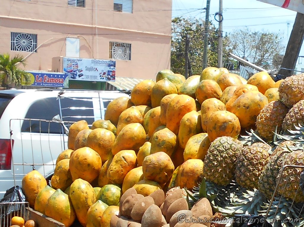 Very ripe and juicy Lechosa / Papaya being sold in the streets.