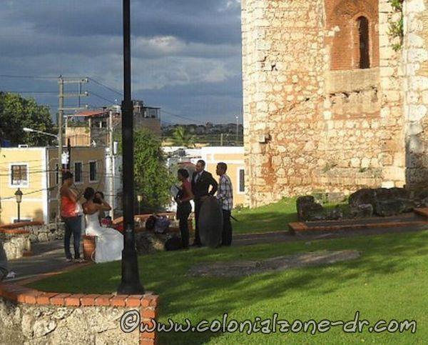 Taking wedding pictures at the Ruinas del Monistario San Francisco under dark skies.