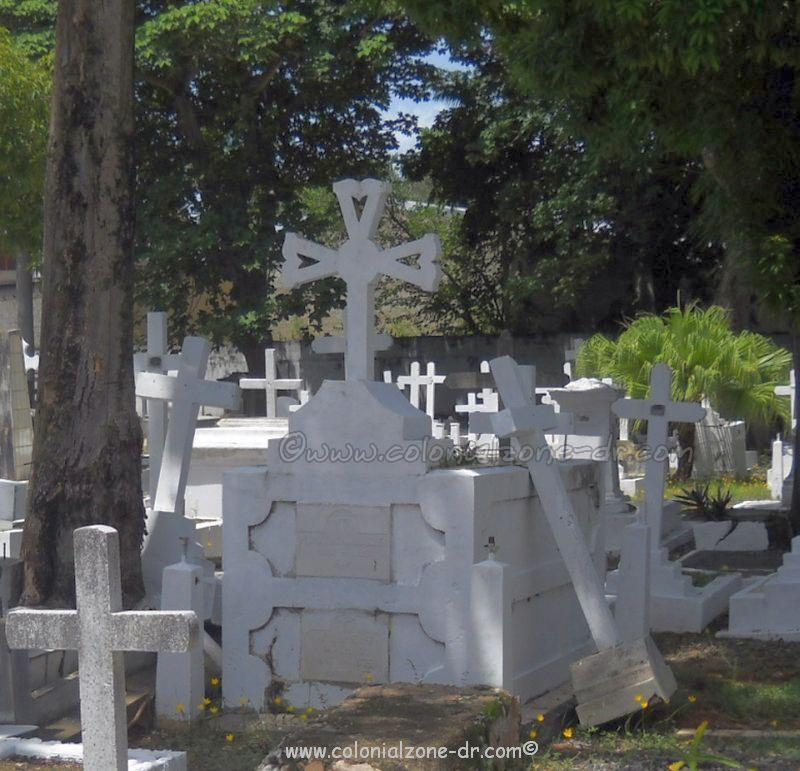 A toppled cross grave at the National Cemetery on Avenue Independencia