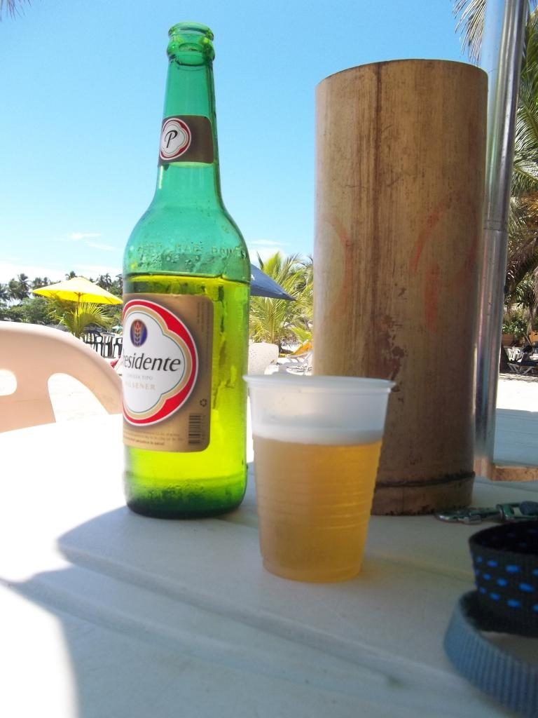 A nice cold NORMAL Presidente beer at the beach
