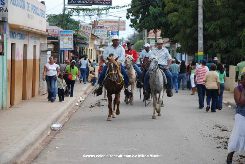 The Festival El Santo Cristo de Bayaguana / Offering of the Bulls - The Vaqueros - Cowboys and their horses are bringing the bulls to town.