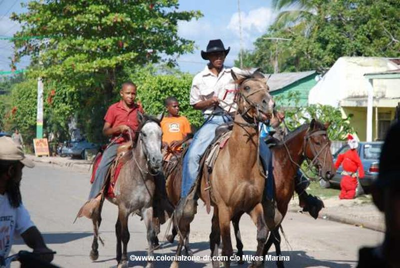 The Festival El Santo Cristo de Bayaguana - Children and adults arrive on horseback.