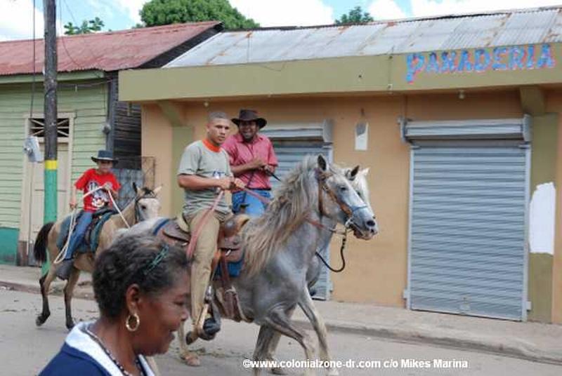 The Festival El Santo Cristo de Bayaguana - Vaqueros arriving on horseback.