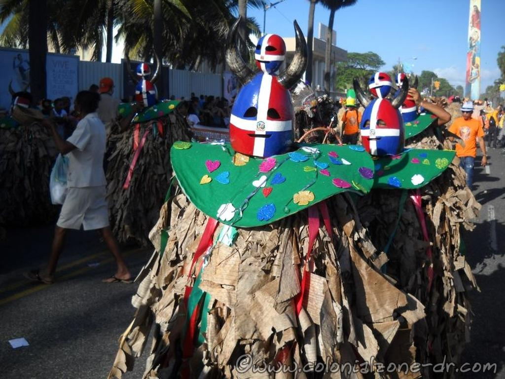 Los Platanuses with a Dominican Flag gourd mask.