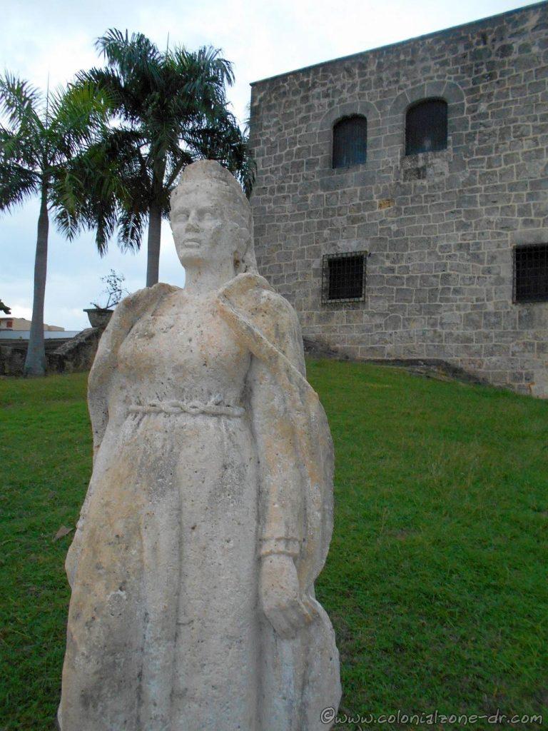 The statue of María de Toledo sitting in its original location on the side of the Alcazar de Colón, her home in the original colony of Santo Domingo.